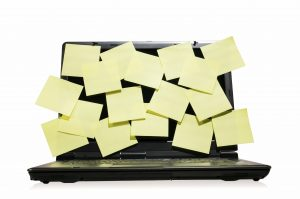 Single modern laptop full of post it on the screen isolated on white background. Space for your text. Busy, hard and stessful job concept.